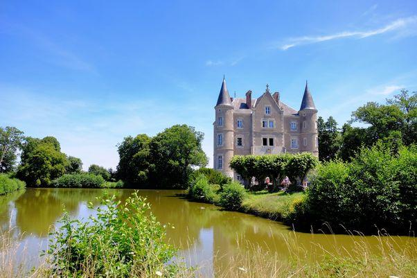 Chateau with moat in foreground
