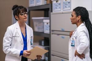 "NEW AMSTERDAM -- ""Double Blind"" Episode 215 -- Pictured: (l-r) Ana Villafañe as Dr. Valentina Castro, Freema Agyeman as Dr. Helen Sharpe -- (Photo by: Zach Dilgard/NBC)"