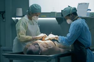 Ep2.  Dwayne Allen (Lovell Adams-Grey) and River Baitz (Kiley May) perform autopsy.