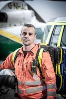 GNAAS Paramedic in front of the helicopter