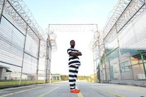 17 year old Tunde from East London at the jail's â¿©heavily guarded entrance.