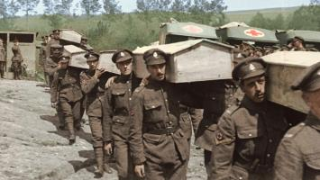 Canadian soldiers carry the coffins of their comrades killed in action.