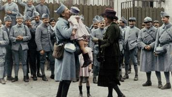 A returning French soldier kisses his little girl.