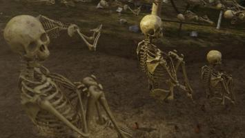Ep2.  CGI.  C/up of skeletons buried in shallow grave with knees bent.