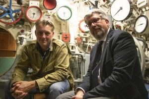 Pictured: James Holland and Dr Jann Witt inside U-boat 995