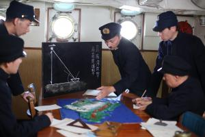 Kent, UK - Mitsuo Fuchida played by Leo Ashizawa going over the final plans for the attack on Pearl Harbour. (Darlow Smithson Productions Ltd)