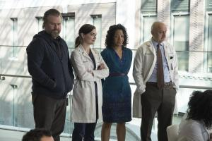 "NEW AMSTERDAM -- ""Pilot"" Episode 101 -- Pictured: (l-r) Tyler Labine as Dr. Iggy Frome, Janet Montgomery as Dr. Lauren Bloom, Zabryna Guevera as Dora Williams, Anupam Kher as Dr. Vijay Kapoor -- (Photo by: Francisco Roman/NBC)"