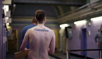 Back of prisoner with â¿¿freedomâ¿¿ tattoo