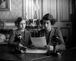 British Royalty, 1940, Princess Elizabeth (later Queen Elizabeth II), right, broadcasting with her sister Princess Margaret alongside. (Photo by Popperfoto via Getty Images/Getty Images). 79666981